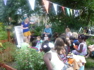 Hayley telling a story at the village-in-the-city fete