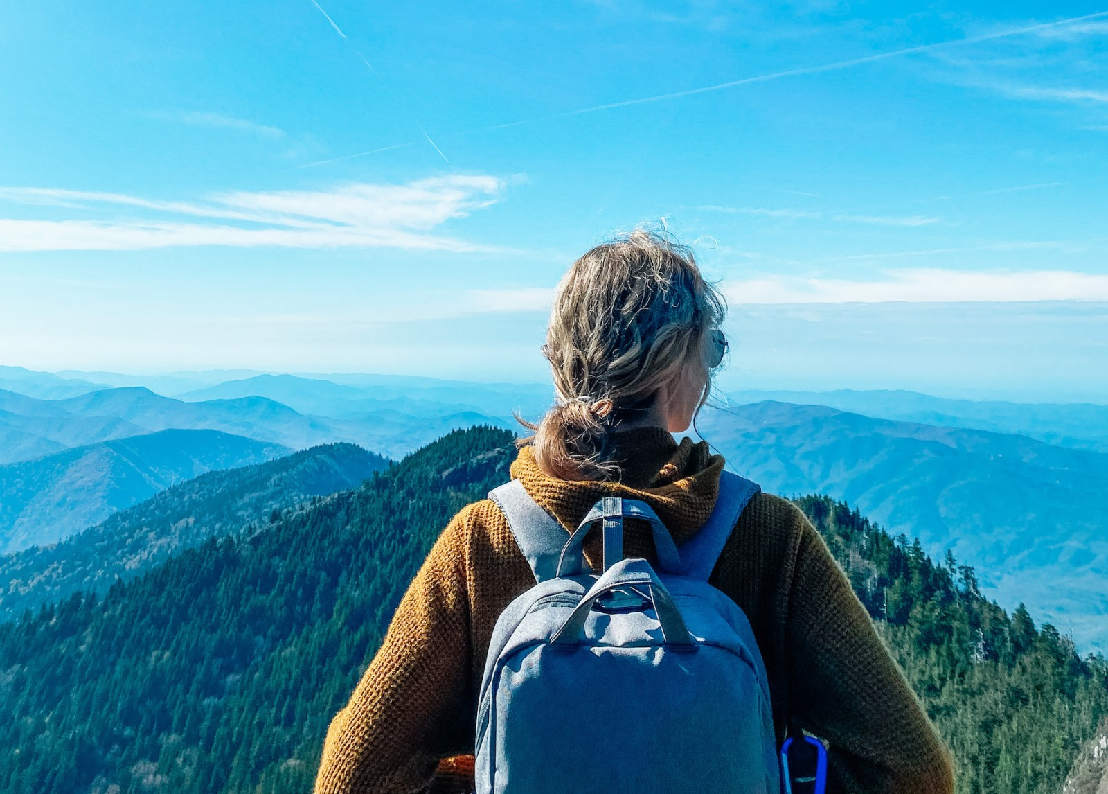 8 Ways to Cope With Eco-Anxiety | Woman gazing out over the mountians