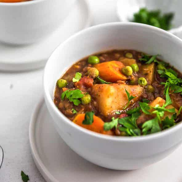 Easy Vegan Recipes | Vegetable stew served in a white bowl