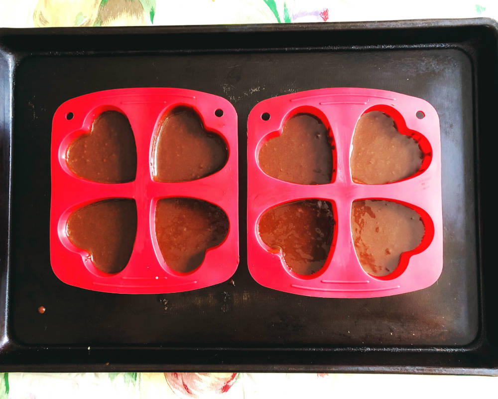 brownie batter in heart-shaped mold