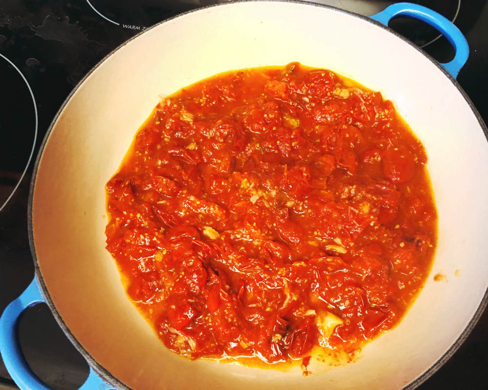 transferring the tomato mixture to pan
