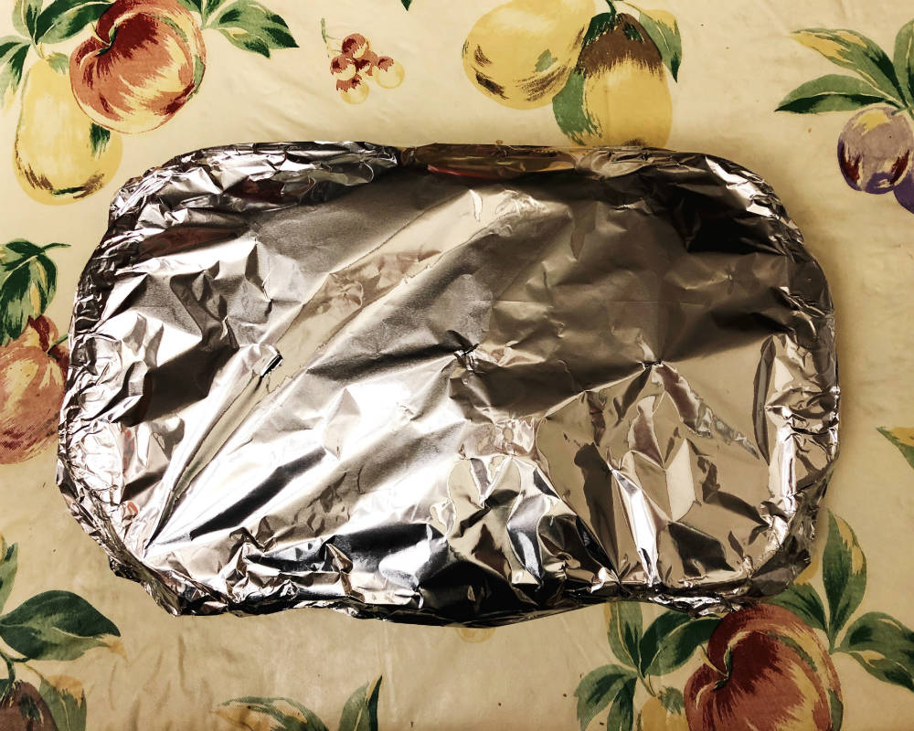 baking dish covered in foil