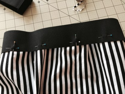 Band pinned to pants