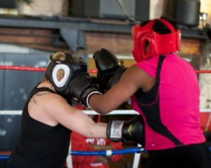 Kristen Wicker and Amelia Robinson spar at Drake's Downtown Gym to prepare for Dayton Knockout.