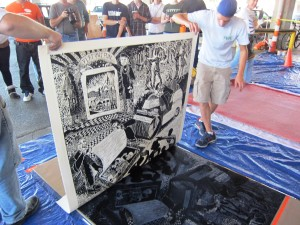 Watch large-scale prints being made with a steamroller at the third Steamroller Printmaking event.
