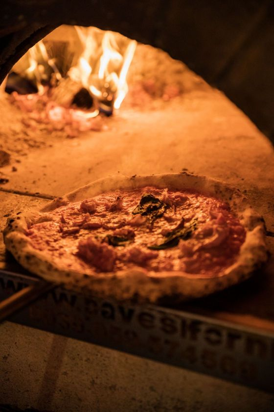 organic sourdough pizza in wood fire oven