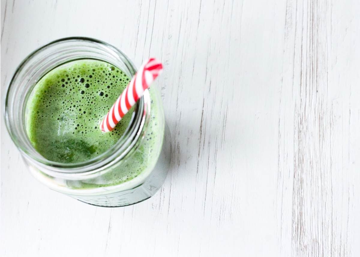 Green smoothie with red straw