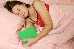 adorable sleeping woman with book