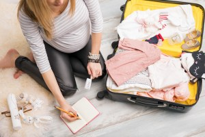 Pregnant woman packing for hospital