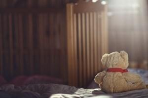 Teddy bear in an empty nursery-bereavement care