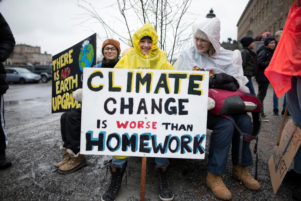 School students who are deciding not to attend classes and instead take part in demonstrations to demand action to prevent further global warming and climate change. © Christian Åslund / Greenpeace