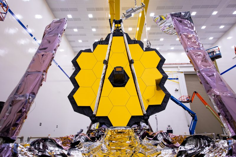 Giant golden hexagon made of smaller hexagons, with foil-covered arms in foreground.