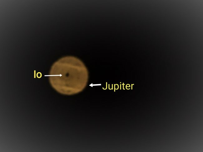 Jupiter, with Io's shadow cast upon it.