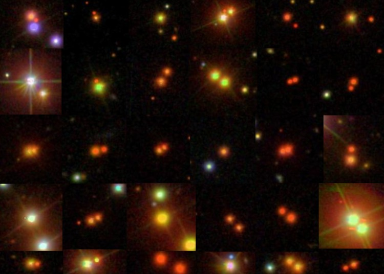 Composite of many pairs of stars in red and yellow hues.