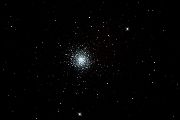 Small but dense spherical cluster of many stars.