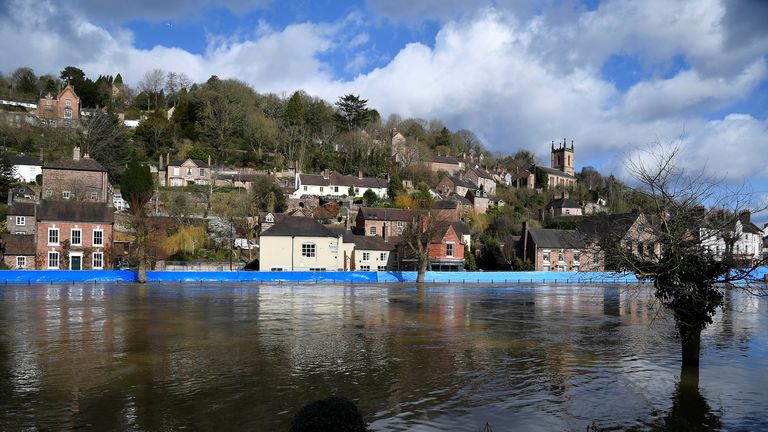 Flood defences, like this temporary one on the River Severn, are a type of climate change adaptation