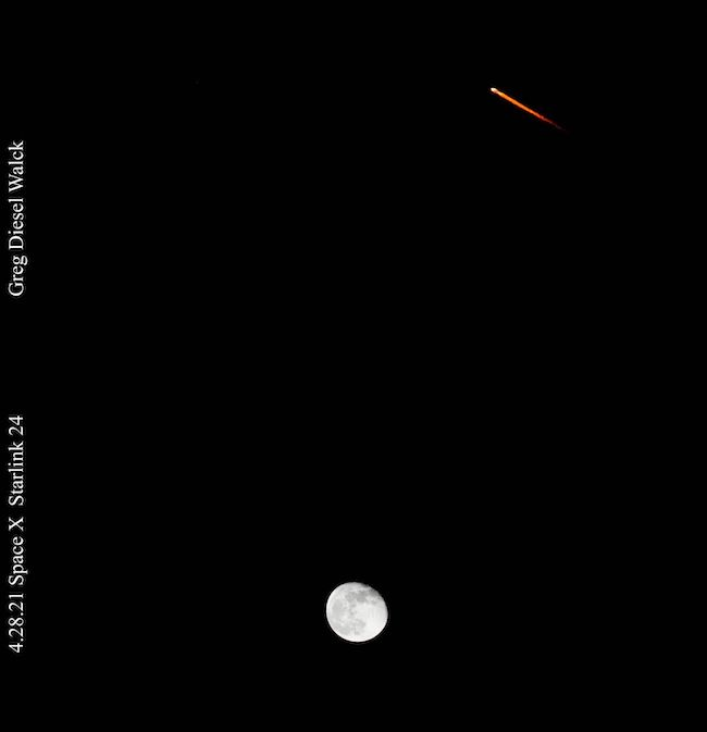 Black background with a bright moon at bottom center and bright dot with diagonal red tail at top right corner.