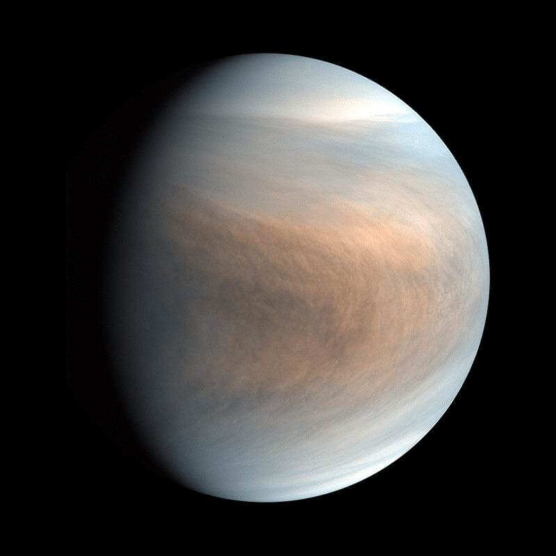 Colorful thick clouds on surface of a planet in space.