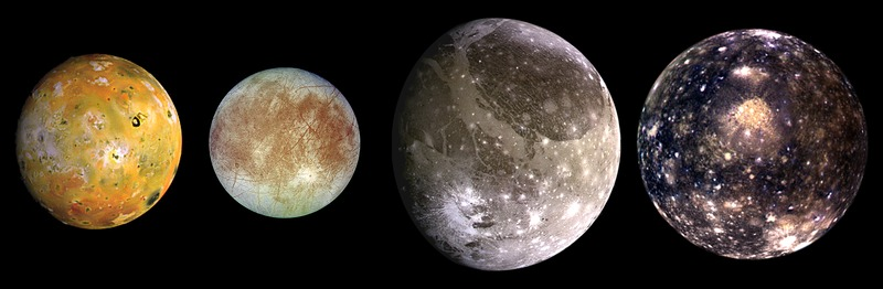 Closeups of spherical, differently patterned, different-sized moons.
