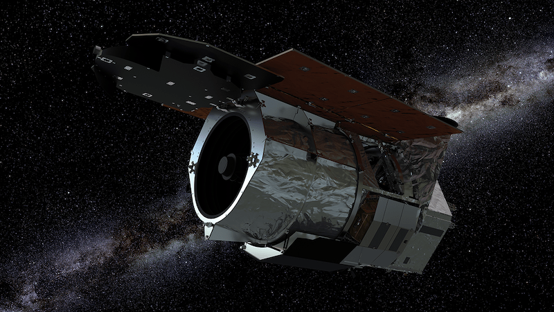Wide, foil-covered open-ended cylinder in space with stars in background.