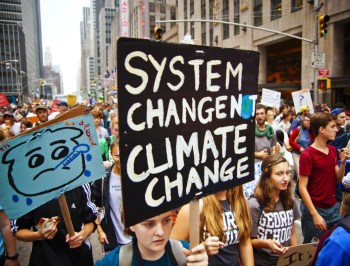 system change not climate change protest
