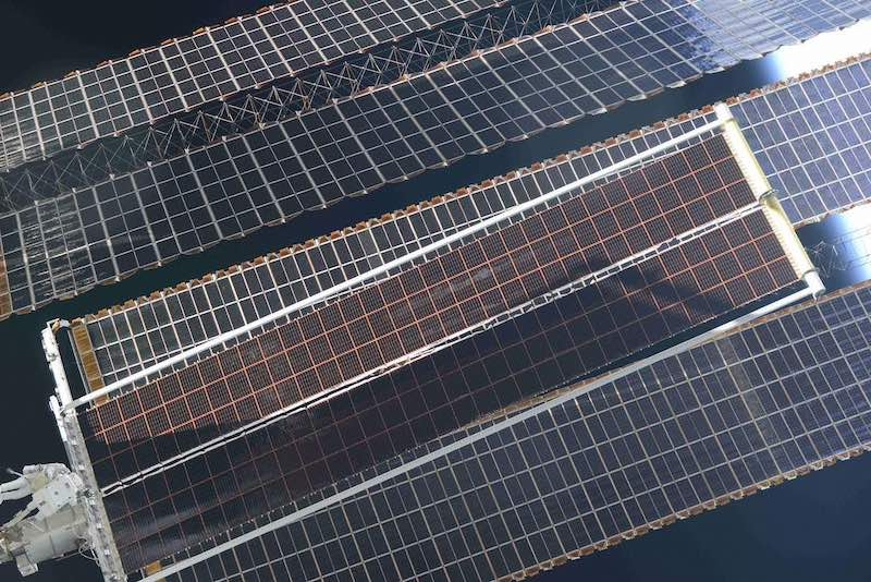 Solar array upgrade of solar panels that look like massive plates with a checkerboard print.