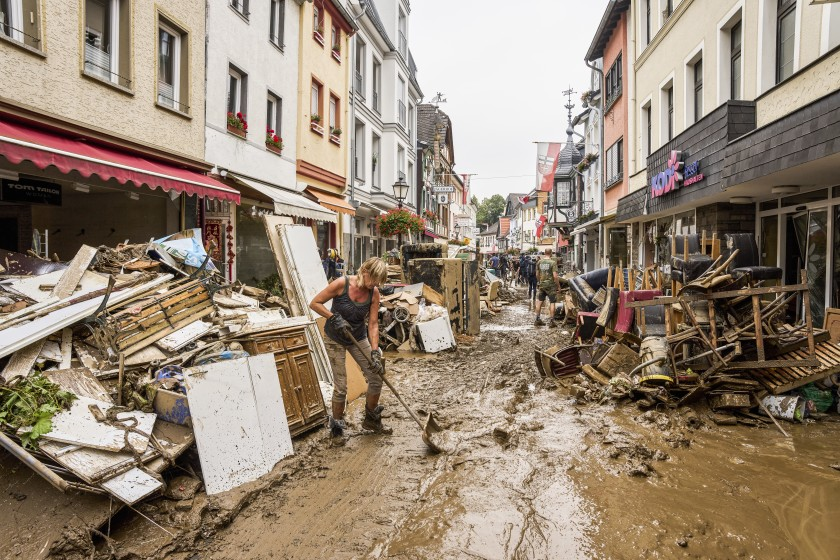 Residents and shopkeepers are trying to clear mud from their homes