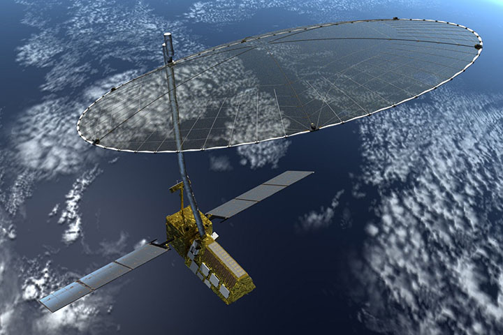 Satellite with wide solar panels and large radar dish orbiting Earth below.