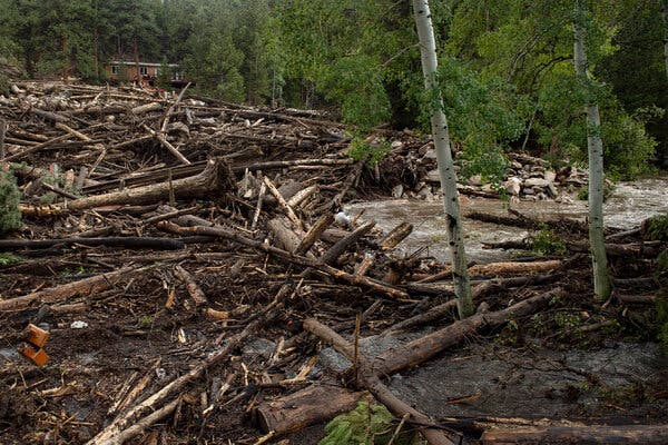 Debris along the Poudre River after a flood and mudslide destroyed an area near Rustic, Colo., last week.