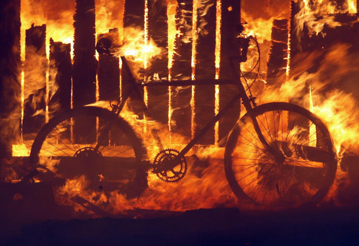 A bicycle burns on an unattended property in a wildfire in the Rancho Santa Fe area of San Diego in 2007.