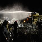 "Police attack ""water protectors"" with pepper spray-infused water cannons in sub-freezing temperatures. (Reuters/Stephanie Keith)"
