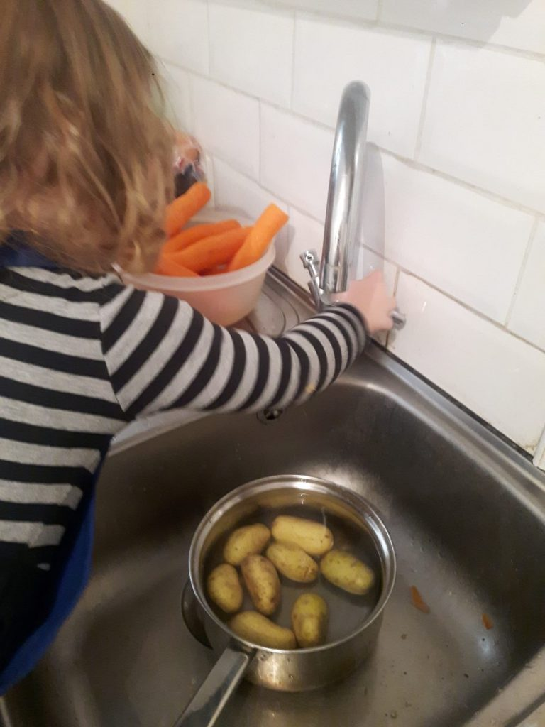 child helping to cook dinner