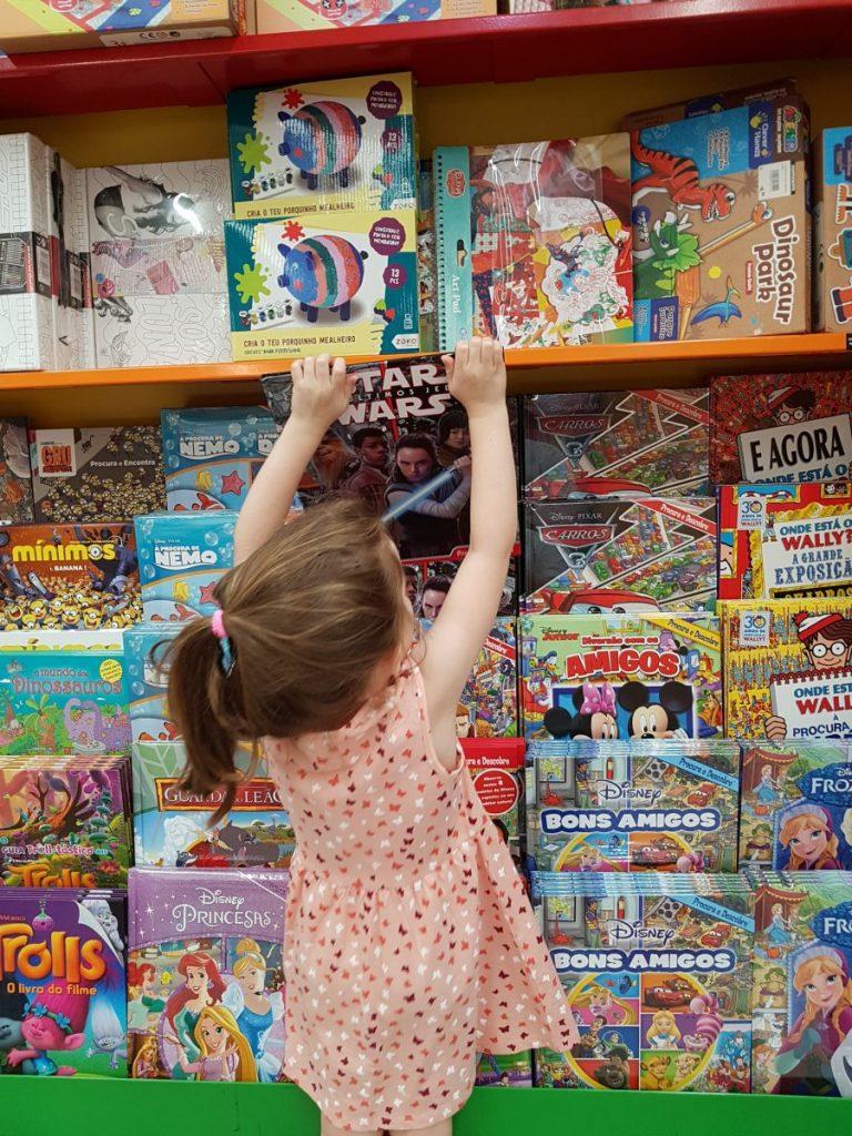 child picking own books
