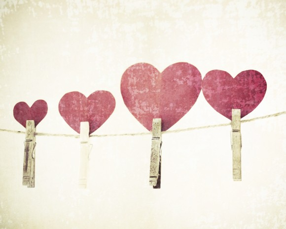 cut-out hearts pinned to a clothes line