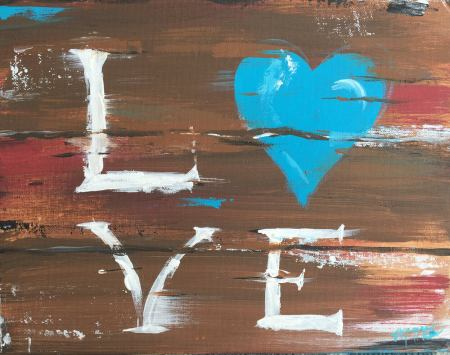 Love painted in white lettering on wooden panels