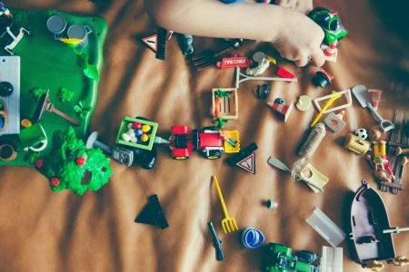 children's toys sprawled out across a leather couch