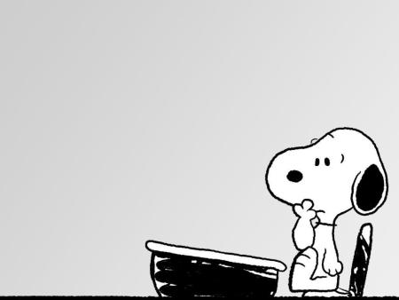 confused snoopy sitting at a school desk