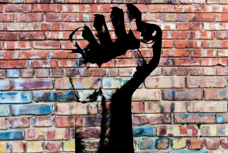Graffiti fist on brick wall