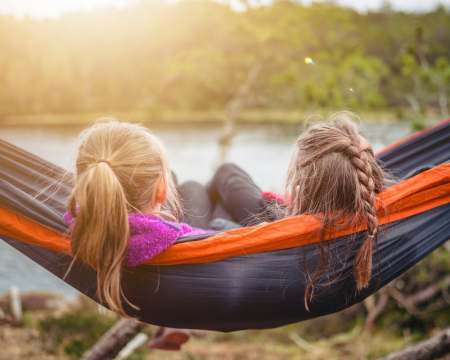 two girls from behind in a hammock
