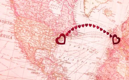 pink map with hearts spanning the Atlantic Ocean