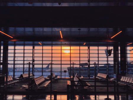 airport window with setting sun