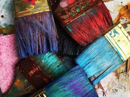 paintbrushes together with lots of colours
