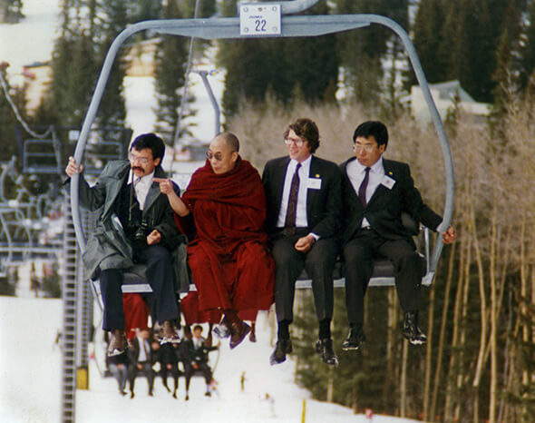 The Dalai Lama on a chairlift in the mountains of New Mexico, April 1991. Credit: Bob Shaw.