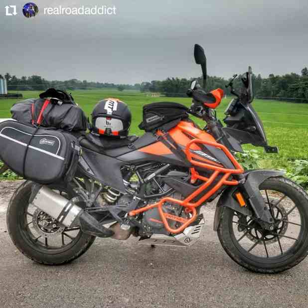 KTM 390 Adventure loaded with accessories like crash guard and engine bash place along with saddle bags.