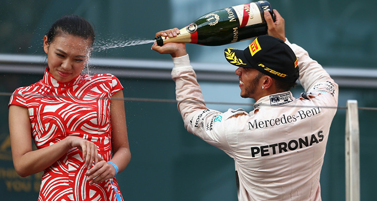 Hamilton sprays podium girl