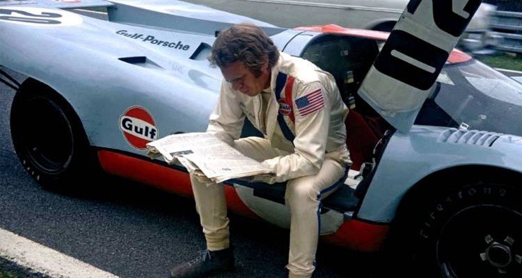 Porsche 917 Le Mans driver reading newspaper