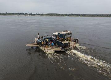 A small vessel across a big river.