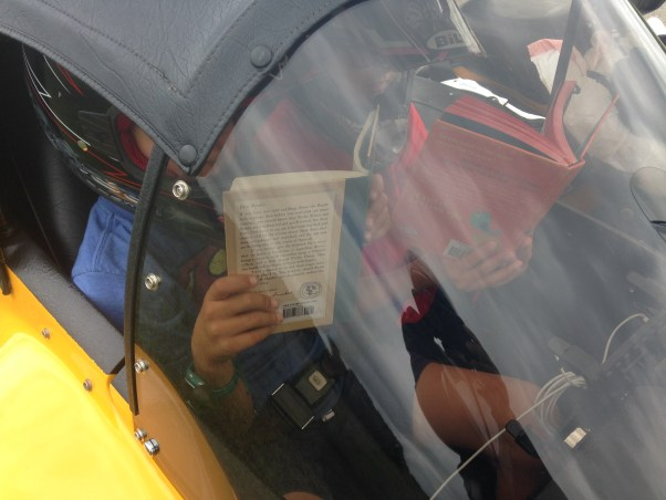 kids reading in the sidecar