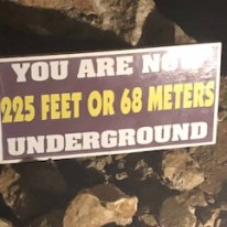 Sign showing depth of cave