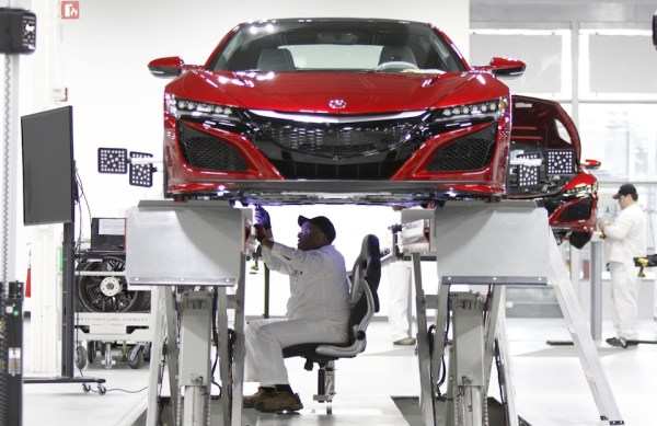 Carl Mason sits in the aligner chair during the wheel alignment process. Because the NSX is so low, associates would have had to be in a crouched position for long periods of time to perform its alignment. This special chair hangs on rails and allows an associate comfort while doing this 45-minute process.